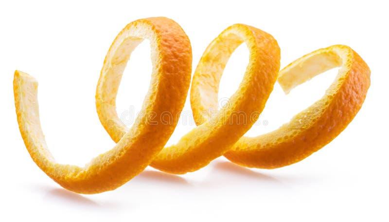 Orange peel or orange twist on white background. Close-up stock photos