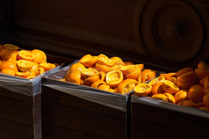 Orange peels in boxes in sunlight. royalty free stock photos