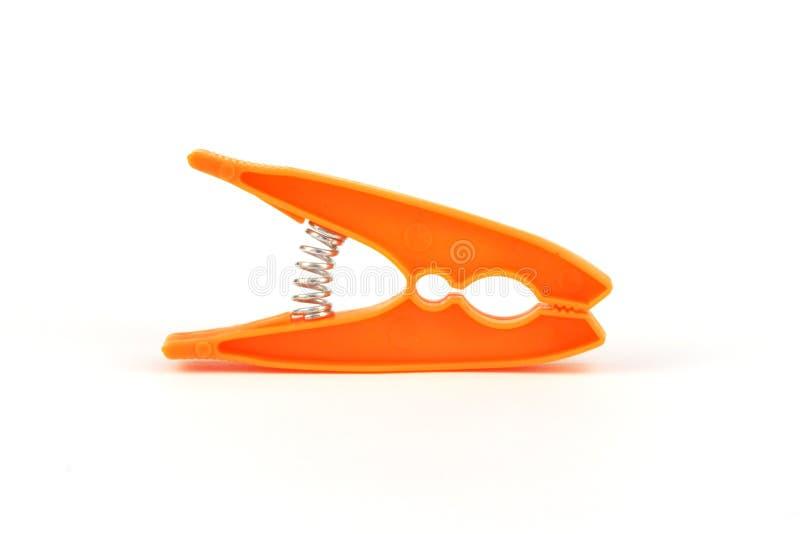 Orange peg. Plastic orange peg royalty free stock image