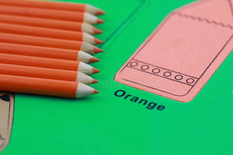 orange pencil crayon stock image