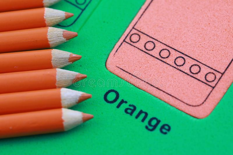 orange pencil crayon stock photo