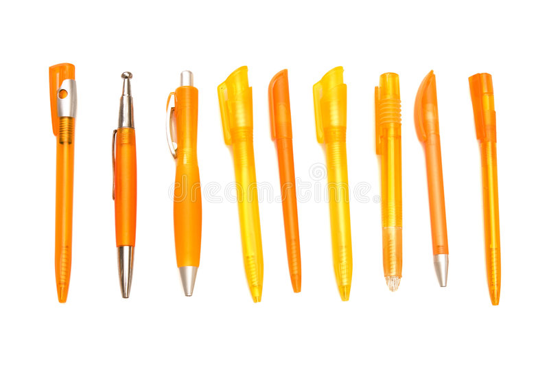 Orange pens on. White ground stock image