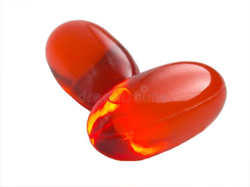 Orange pills royalty free stock images