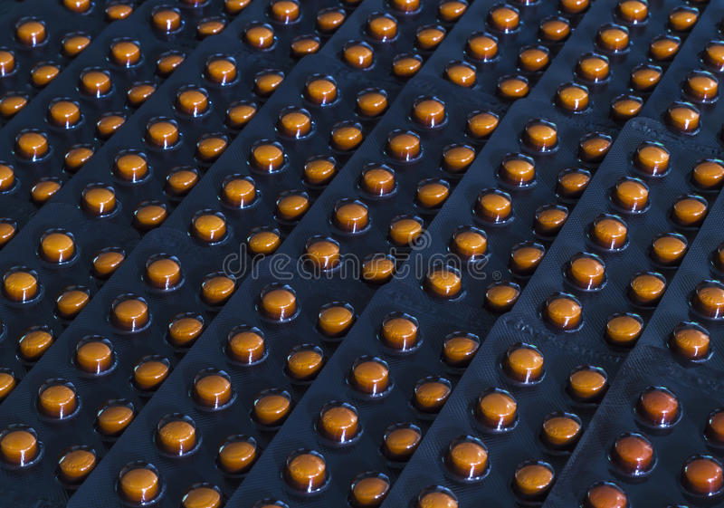 Download Orange Pills In Black Blister Pack Stock Image - Image of herb, painkiller: 39508447