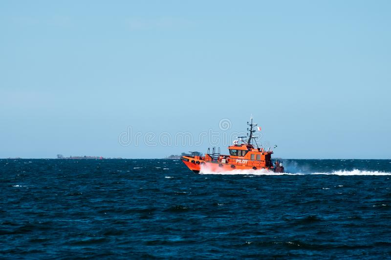 Orange Pilot Boat at Speed royalty free stock images