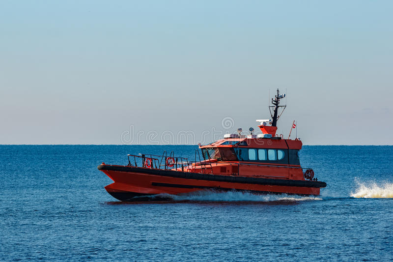 Orange pilot ship royalty free stock photography