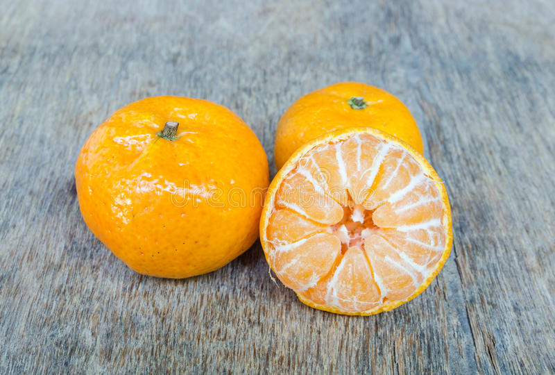 Orange placed on a wooden table. stock photo