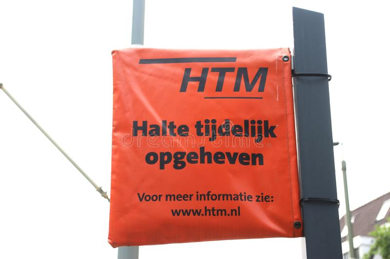 Orange plastic bag around tram stop sign due to temporary closing of the stop by HTM in The Hague. royalty free stock images