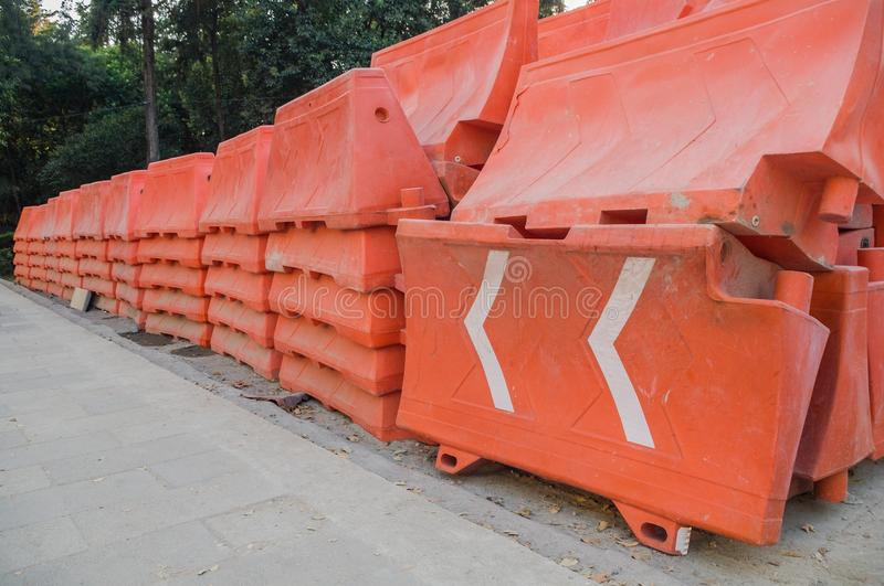 Orange plastic barriers stacked on an avenue in Mexico City. stock images