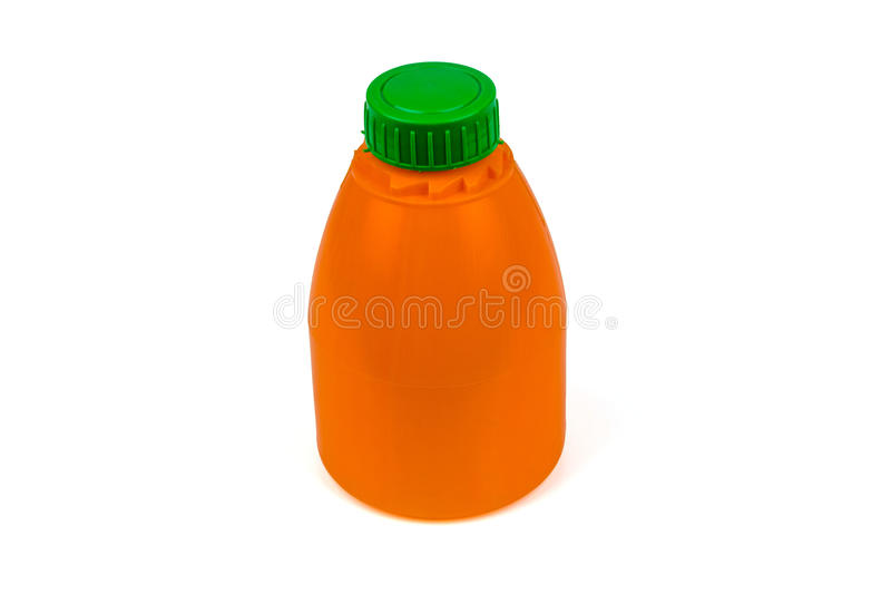 Orange plastic bottle with green cup. Orange plastic bottle with green cup isolated on a white background royalty free stock photography