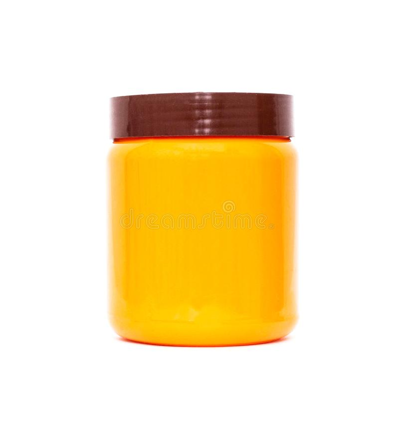 Orange plastic jar with a lid on a white background, isolate, tara stock photography