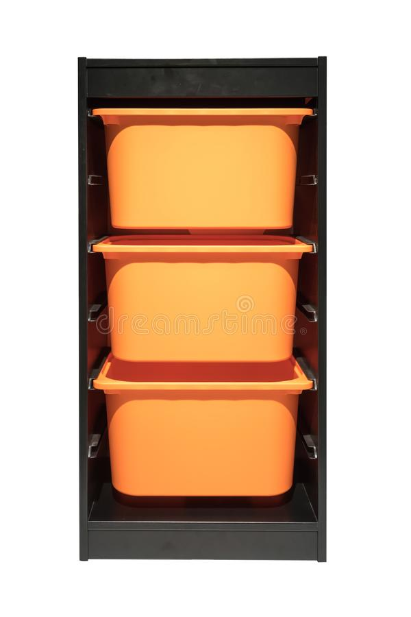 Orange plastic storage drawer in black cabinet for room organize. R isolated on white background stock images