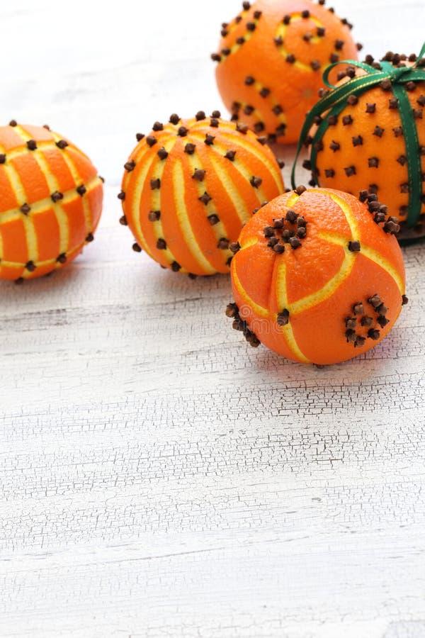 Orange pomanderbollar för kryddnejlika arkivfoto