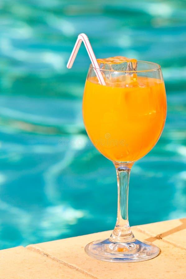 orange poolside royaltyfria bilder
