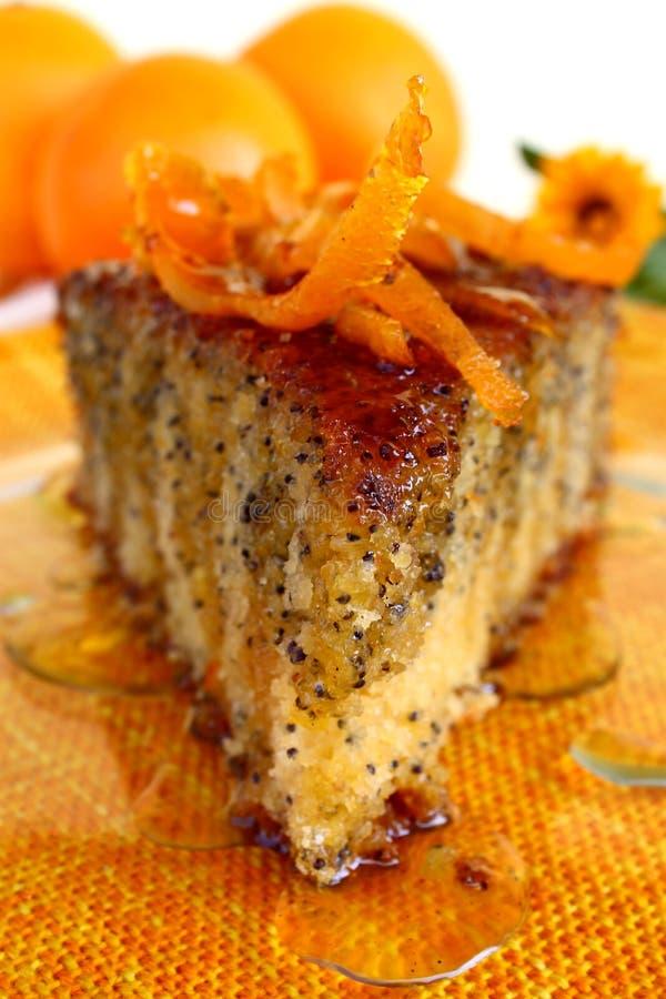 Orange poppy seeds tart. An orange poppy seeds sweet tart slice with orange syrup royalty free stock images