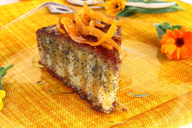 Orange poppy seeds tart. An orange poppy seeds sweet tart slice with orange syrup stock image