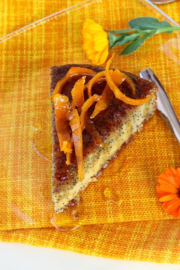 Orange poppy seeds tart. An orange poppy seeds sweet tart slice with orange syrup stock photography