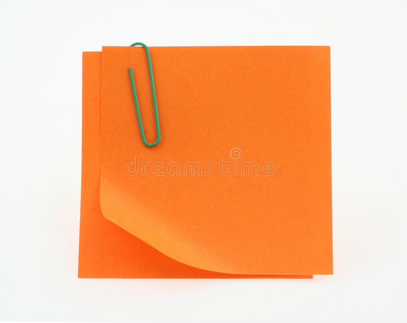 Orange post-it notes with a bent corner on white stock photography