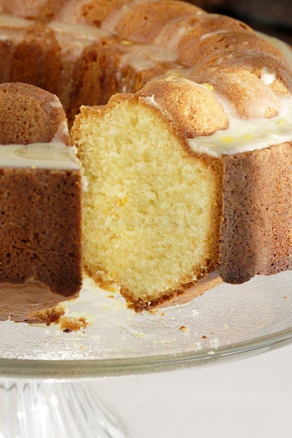 Orange pound cake. Delicious bundt cake with orange glaze icing stock images