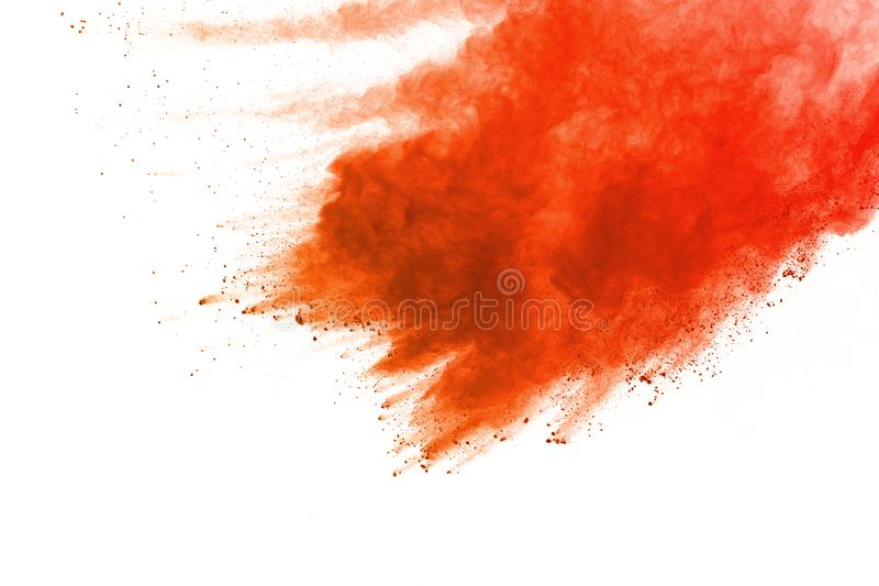 Orange powder explosion on white background. Colored cloud. Colorful dust explode. Paint Holi stock image