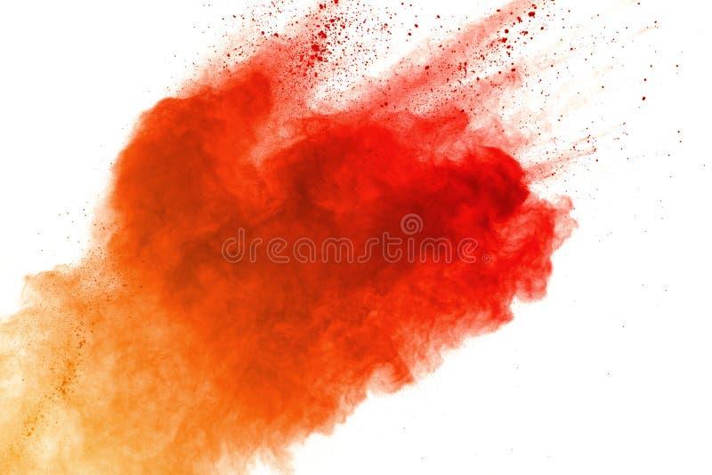 Orange powder explosion on white background. Colored cloud. Colorful dust explode. Paint Holi stock photo