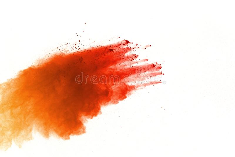 Orange powder explosion on white background. Colored cloud. Colorful dust explode. Paint Holi royalty free stock photos