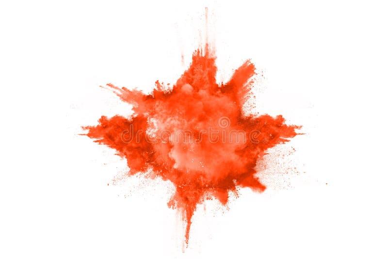 Orange powder explosion on white background. royalty free stock photo