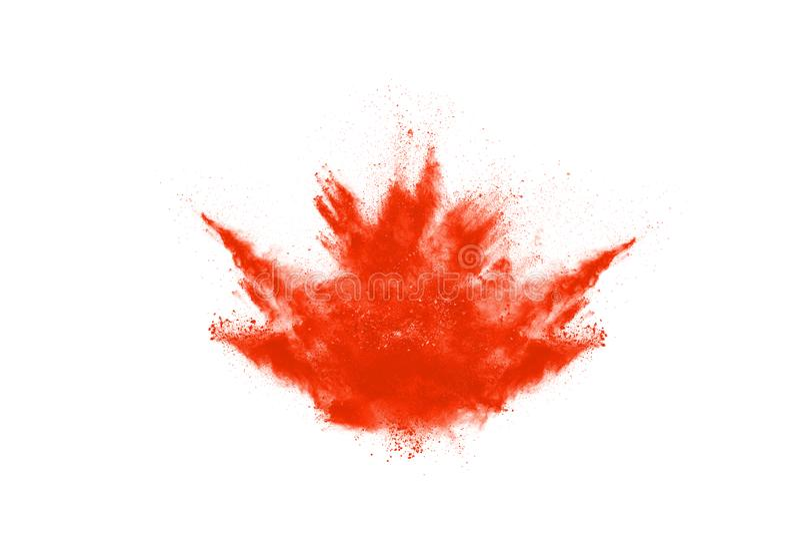 Orange powder explosion on white background. Colored cloud. Colorful dust explode. Paint Holi stock photos