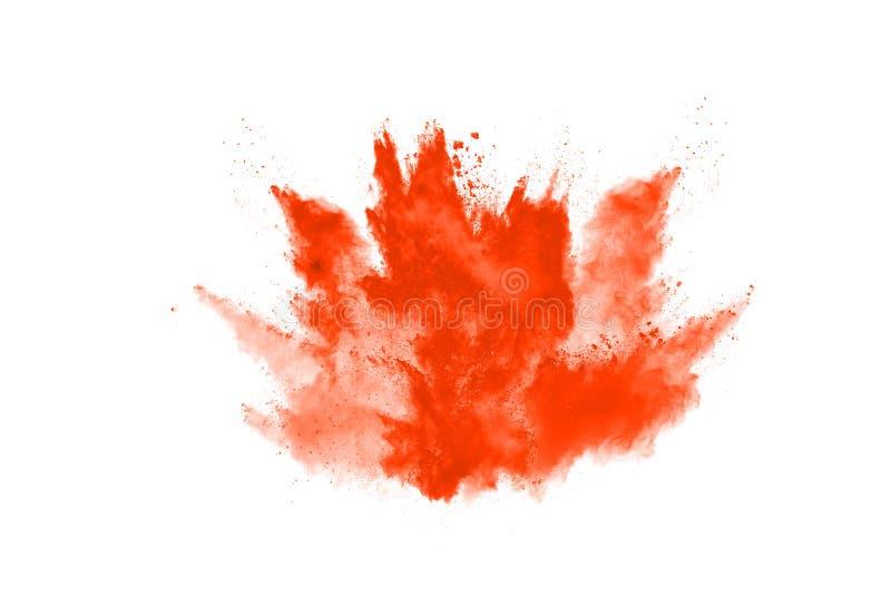 Orange powder explosion on white background. Colored cloud. Colorful dust explode. Paint Holi royalty free stock photo