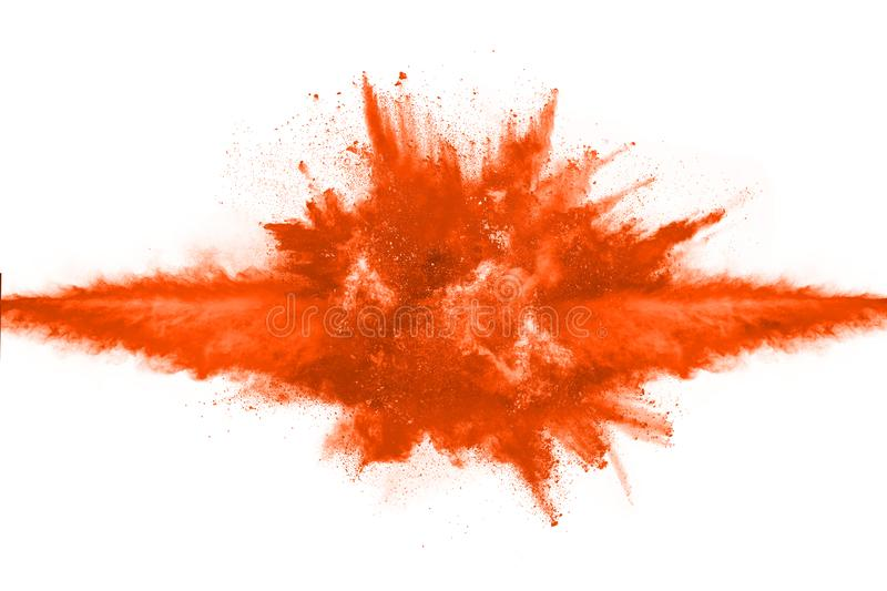 Orange powder explosion on white background. Colored cloud. Colorful dust explode. Paint Holi stock photography