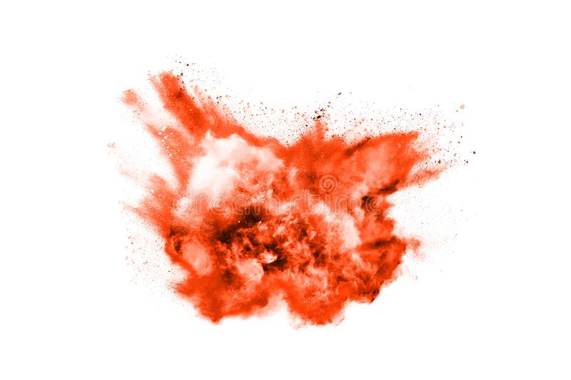Orange powder explosion on white background. Colored cloud. Colorful dust explode. Paint Holi royalty free stock images
