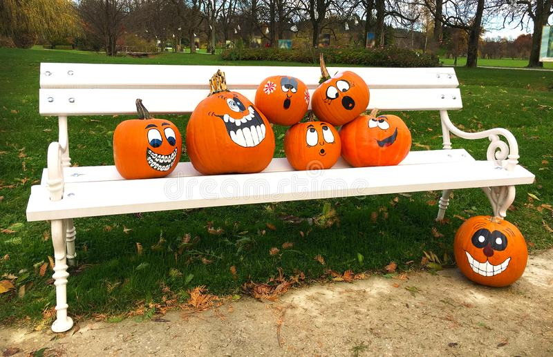 fall harvest decorations outdoors orange pumpkins with funny drawn faces as decoration for outdoor  orange pumpkins with funny drawn faces