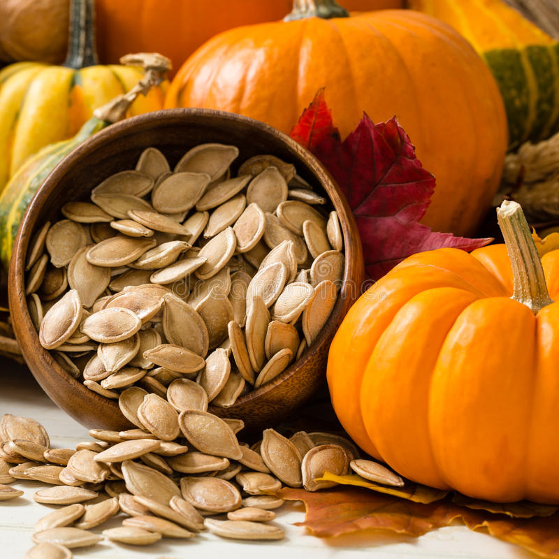 Orange Pumpkins With Toasted Pumpkin Seeds stock images