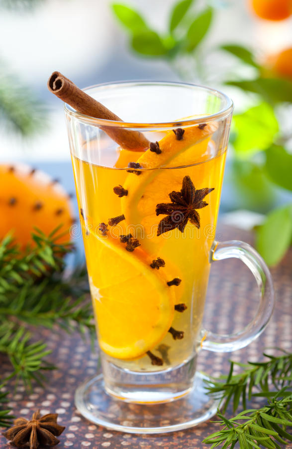 Orange punch. With fruit slices and spices.Hot drink for winter and Christmas stock photos