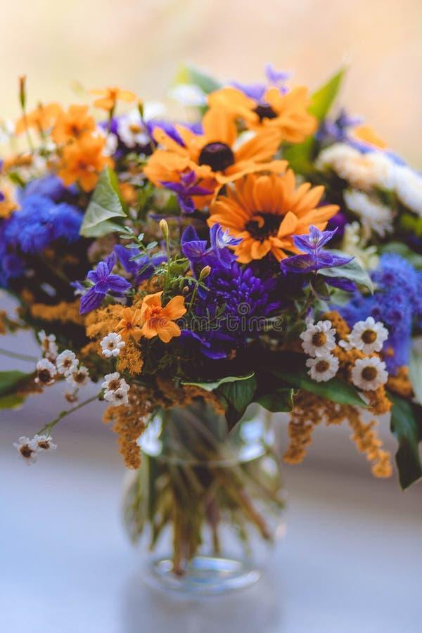Orange Purple Green and White Flowers Decor stock photos