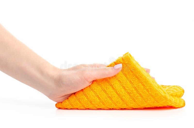 The orange rag cloth in hand. On white background isolation stock photo