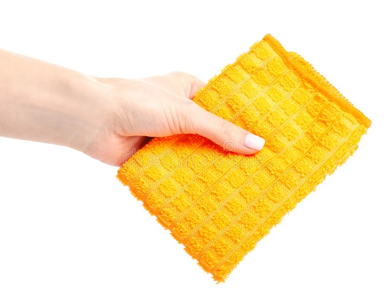 The orange rag cloth in hand. On white background isolation stock photography