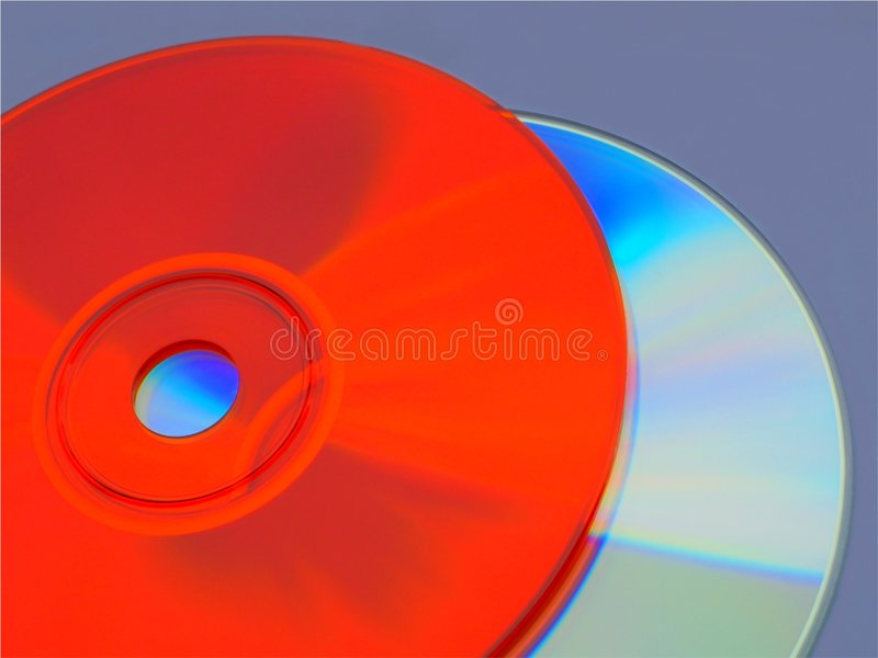Orange and rainbow cds stock photography