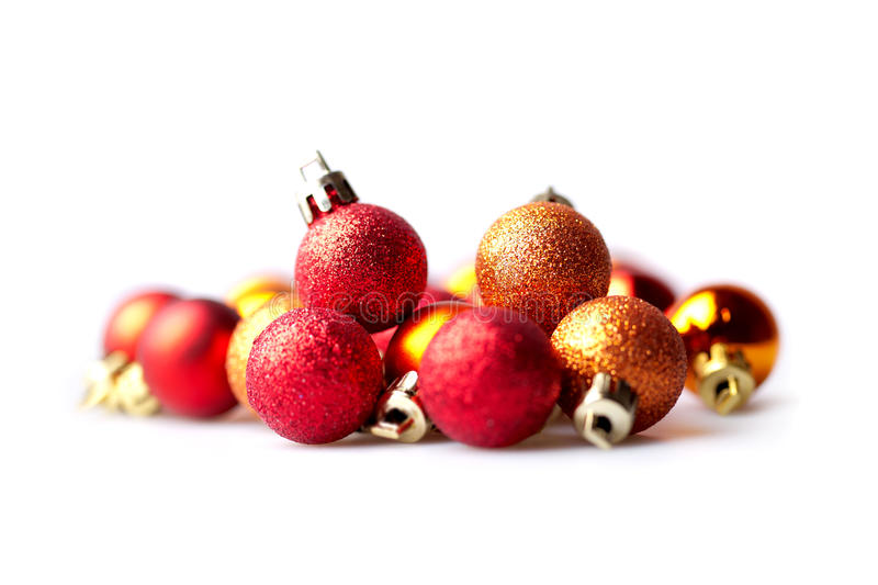 Orange and red christmas balls. On isolated white background stock image