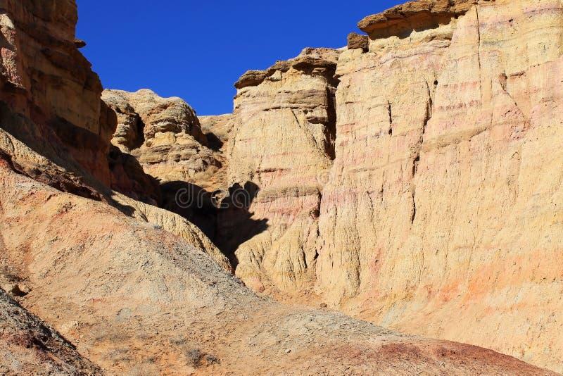 Orange and red coloured cliffs of Tsagaan Suvraga, in the Gobi desert, Dundgovi Province, Mongolia. Yellow and red coloured cliffs of Tsagaan Suvraga Â«  stock images