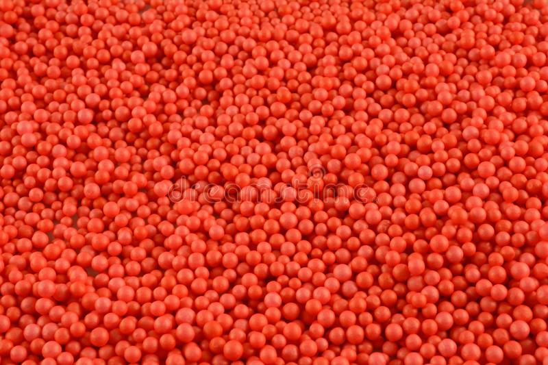 Orange red polystrene ball background. Background of crowd orange red polystrene balls for concept of uniformity or sameness royalty free stock photo