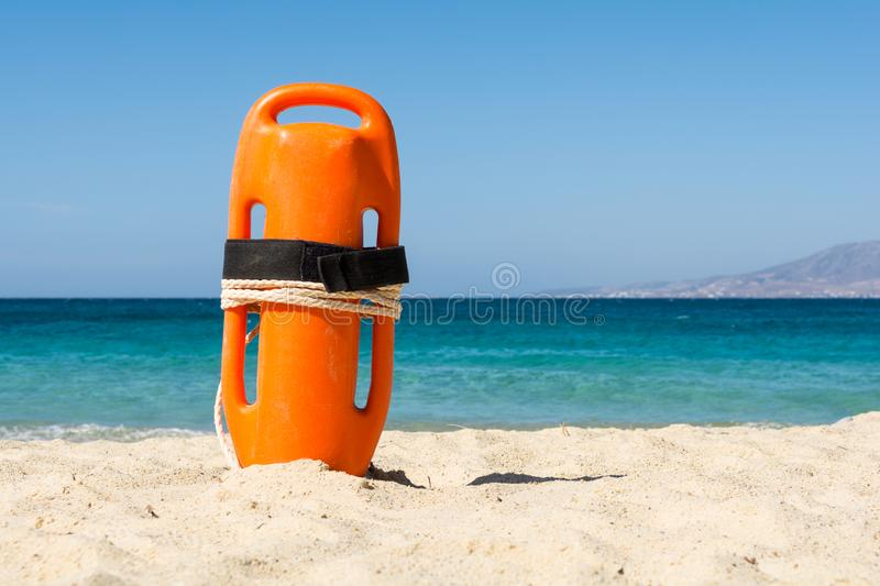 Orange rescue buoy on the beach.  stock photography