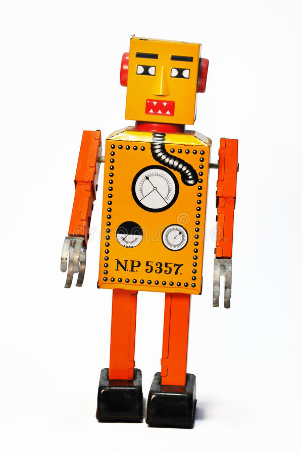 Orange retro robot wind up toy. stock image