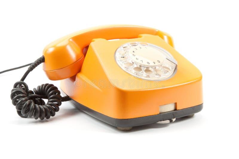 Orange Retro- Telefon lizenzfreies stockfoto