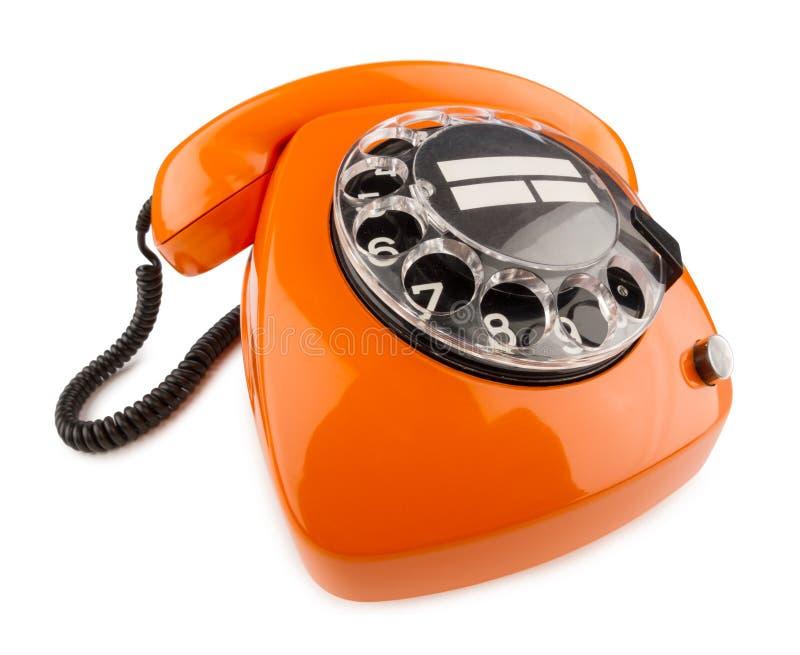 Orange retro telefon arkivfoton