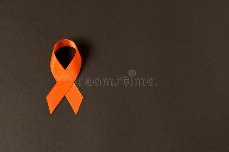 Orange ribbon. Healthcare and medicine concept. Multiple Sclerosis awareness. Leukemia awareness. Empty text space.  royalty free stock image