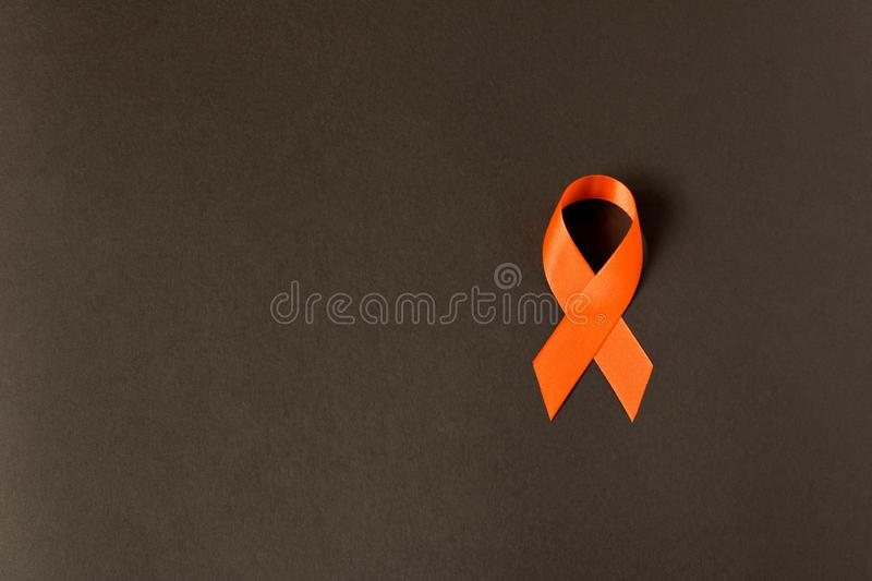 Orange ribbon. Healthcare and medicine concept. Multiple Sclerosis awareness. Leukemia awareness. Empty text space.  royalty free stock images