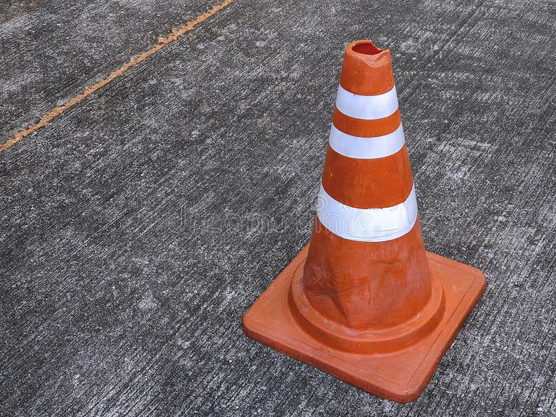 Orange Road Traffic Cone with White Stripes on Street stock image