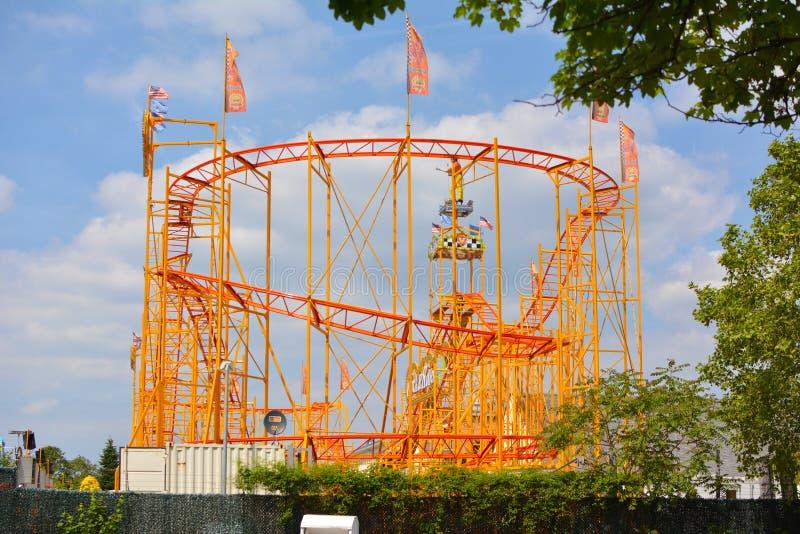 Orange roller coaster ride at funfair as part of `Festival of German-American Friendship in Heidelberg royalty free stock photo