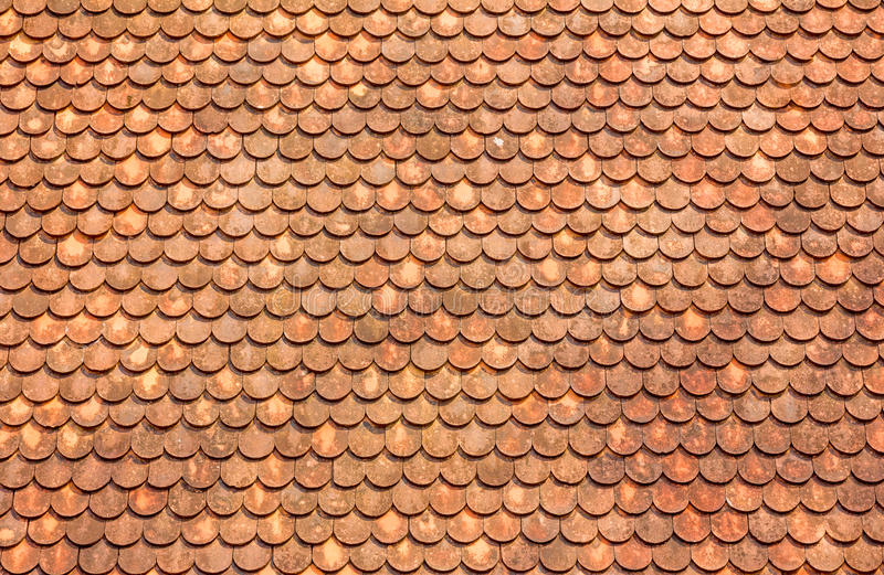 Orange roof tiles stock images